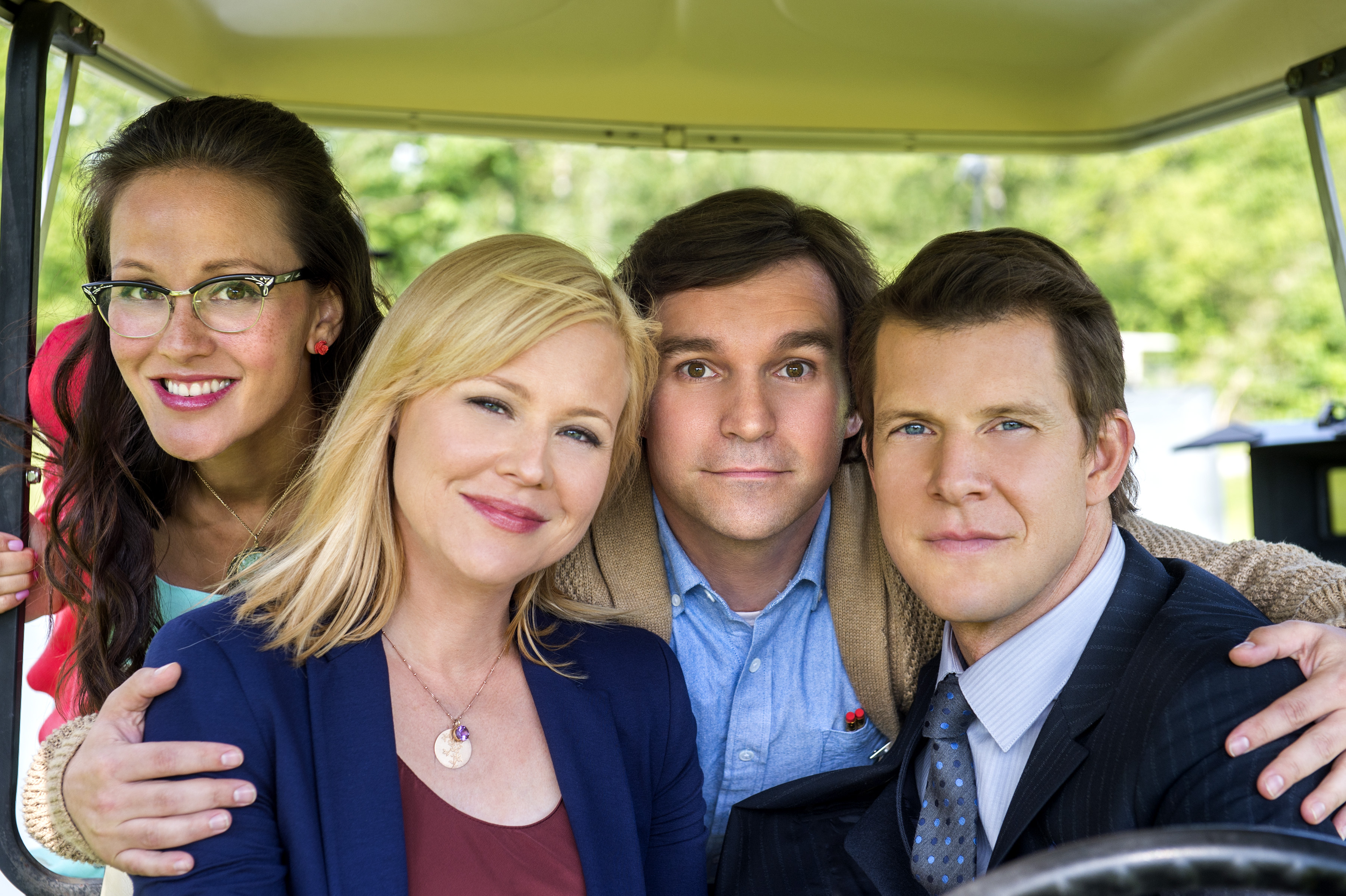 Crystal Lowe as Rita Haywith, Geoff Gustafson as Norman Dorman, Eric Mabius as Oliver O'Toole and Kristin Booth as Shane McInerney in Signed, Sealed, Delivered (2013)