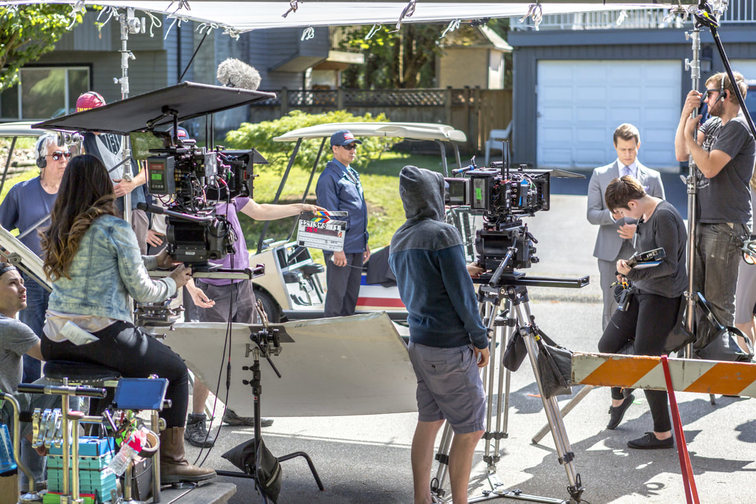 Cast and crew filming Signed, Sealed, Delivered: One In A Million