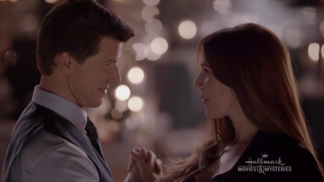 Eric Mabius as Oliver O'Toole and Poppy Montgomery as Holly O'Toole in Signed, Sealed, Delivered: From Paris With Love